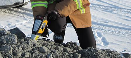 Olympus Innov-X DELTA handheld XRF mining analyzer testing metal content in ore.
