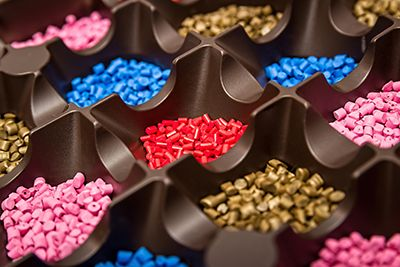 The raw plastic pellets used in injection molding