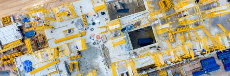 Aerial view construction engineers working at construction site